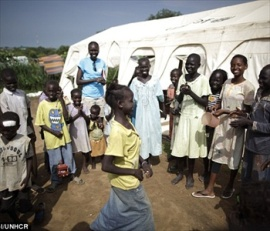 securedownload alke with children in south Sudan