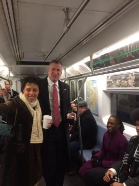 Mayor de Blasio & family on the subway to City Hall/Uli Seit - NY Times