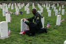 Staff Sargent and Son honor a fallen soldier - www.riley.army.mil
